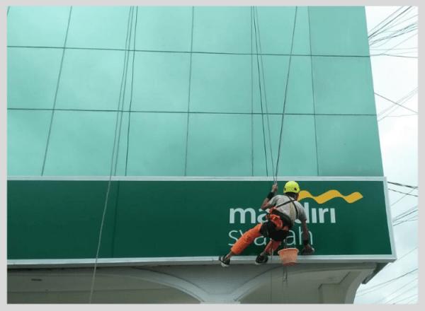 service kaca gedung